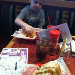 Photo taken at Red Robin Gourmet Burgers by Andrea M. on 12/18/2012