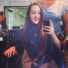 Photo taken at Empire Hair Studio by Jackie B. on 9/8/2014