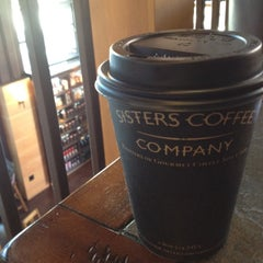 Photo taken at Sisters Coffee Company by Thandi C. on 4/22/2012