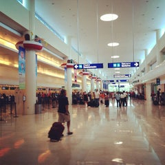 Photo taken at Aeropuerto Internacional De Cancún (CUN) by Павел К. on 8/30/2013