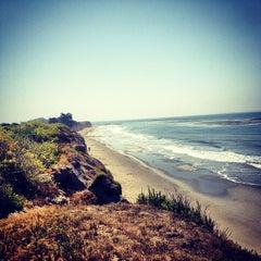 Photo taken at Isla Vista Beach by Erin J. on 4/27/2013