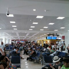 Photo taken at Aeropuerto Internacional De Cancún (CUN) by Oscar R. on 8/25/2013