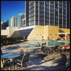 Photo taken at Hilton Hotel Rooftop Pool by Walter C. on 10/16/2013
