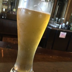 Photo taken at Fairhope Brewing Company by Caitlin W. on 5/23/2015