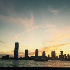 Photo taken at Battery Park City by Madhawi A. on 7/23/2015