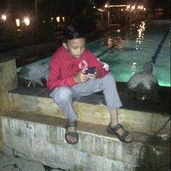 Photo taken at Pantai Mutiara Swimming Pool by louisa d. on 7/5/2014