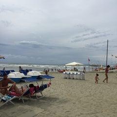 Photo taken at Lido Beach Spiaggia Libera Lido Di Camaiore by Aleksandr Y. on 8/15/2015