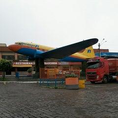 Photo taken at Posto do Avião by Ketryn S. on 3/22/2014