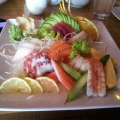 Photo taken at Tee Jay Thai Sushi by Kelley L. on 12/23/2012