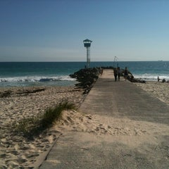 Photo taken at City Beach by Charlie C. on 8/25/2012