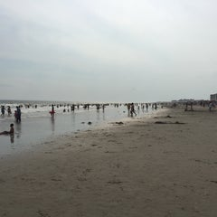 Photo taken at Rockaway Beach by Shai G. on 8/30/2015