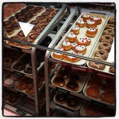 Photo taken at Krispy Kreme Doughnuts by Joe D. on 12/28/2012
