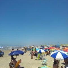 Photo taken at Praia de Imbé by Sergio B. on 1/4/2013