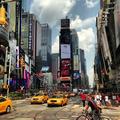 Photo taken at Times Square by Armando C. on 7/19/2013