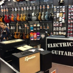 Photo taken at Guitar Center by João M. on 12/29/2013