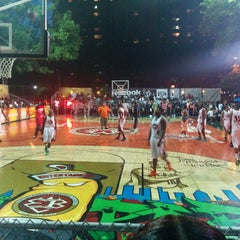 Photo taken at Rucker Park Basketball Courts by David Z. on 8/8/2014