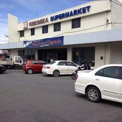 Photo taken at Merdeka Supermarket by Lee O. on 1/5/2014