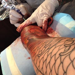 Photo taken at Remington Tattoo by joey f. on 2/1/2014