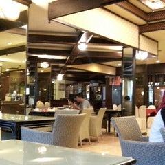 Photo taken at Regent's Park Hotel by Dina T. on 7/23/2015