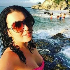 Photo taken at Tegal Wangi Beach by Lilia Z. on 1/17/2016