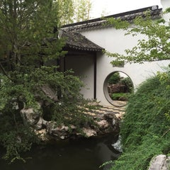 Photo taken at Chinese Scholars' Garden by Julius T. on 7/4/2015
