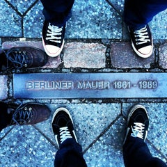Photo taken at Baudenkmal Berliner Mauer   Berlin Wall Monument by Marcelo F. on 5/19/2013