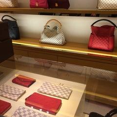 Photo taken at Louis Vuitton by EL M. on 7/16/2015
