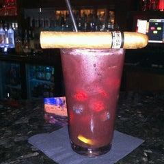 Photo taken at LIT Premium Cigar Lounge by Michael D. on 2/11/2013