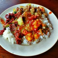 Photo taken at Restoran Sri Bunga by Aiman Zhafransyah on 2/29/2012