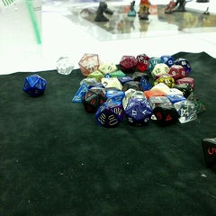 Photo taken at Madness Games and Comics by Christopher P. on 3/22/2012