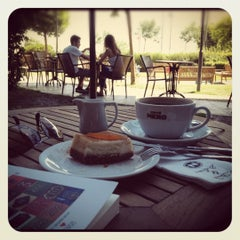 Photo taken at Caffé Nero by Ozge B. on 6/13/2012