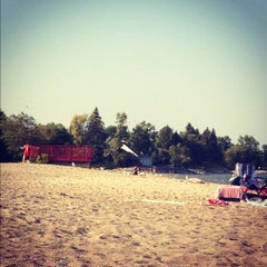 Photo taken at Gimli Public Beach by Emily on 8/30/2012