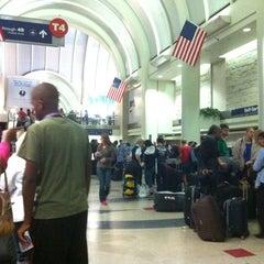Photo taken at Terminal 4 by Derick T. on 7/28/2012