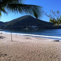 Photo taken at Praia Martim de Sá by Isabelle R. on 7/3/2012