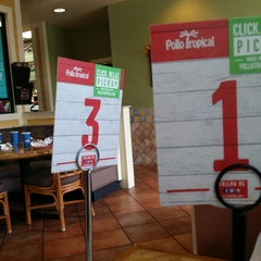 Photo taken at Pollo Tropical by Victor N. on 11/9/2014