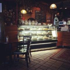 Photo taken at Three Monkeys Coffee & Tea House by Aga K. on 11/15/2013