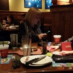 Photo taken at Outback Steakhouse by Brandon G. on 12/5/2013
