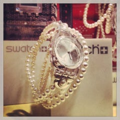 Photo taken at Swatch by Fabio M. on 12/20/2013