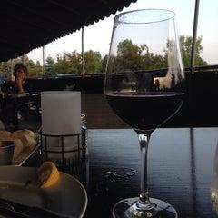 Photo taken at YOLO Restaurant + Lounge by David M. on 8/28/2015