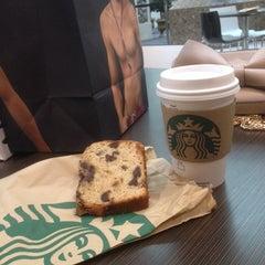 Photo taken at Starbucks by Sam C. on 3/21/2014
