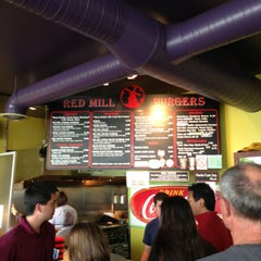 Photo taken at Red Mill Burgers by C.Y. L. on 7/28/2013