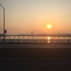 Photo taken at 잠실대교 (Jamsil Bridge) by Hyungmin P. on 7/3/2015