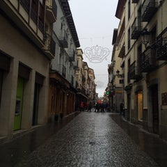 Photo taken at Calle Mayor by Marina M. on 1/5/2014