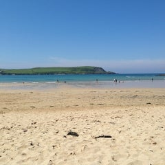 Photo taken at Daymer Bay by Ella O. on 5/31/2013
