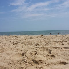 Photo taken at 59th St Beach by Scott C. on 8/10/2013