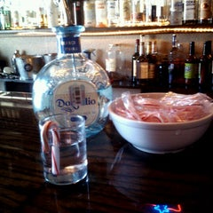 Photo taken at Gourmands Neighborhood Pub by Hannah S. on 12/20/2012