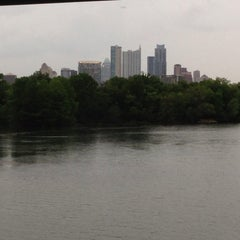 Photo taken at Lady Bird Lake Under Mopac Bridge by Javi T. on 5/10/2013