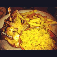 Photo taken at Nando's by Carlos R. on 11/19/2012