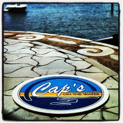 Photo taken at Cap's on the Water by Adam J. on 8/10/2013