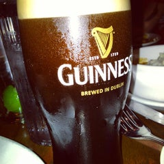Photo taken at Rí Rá Irish Pub by Alexander T. on 5/9/2013